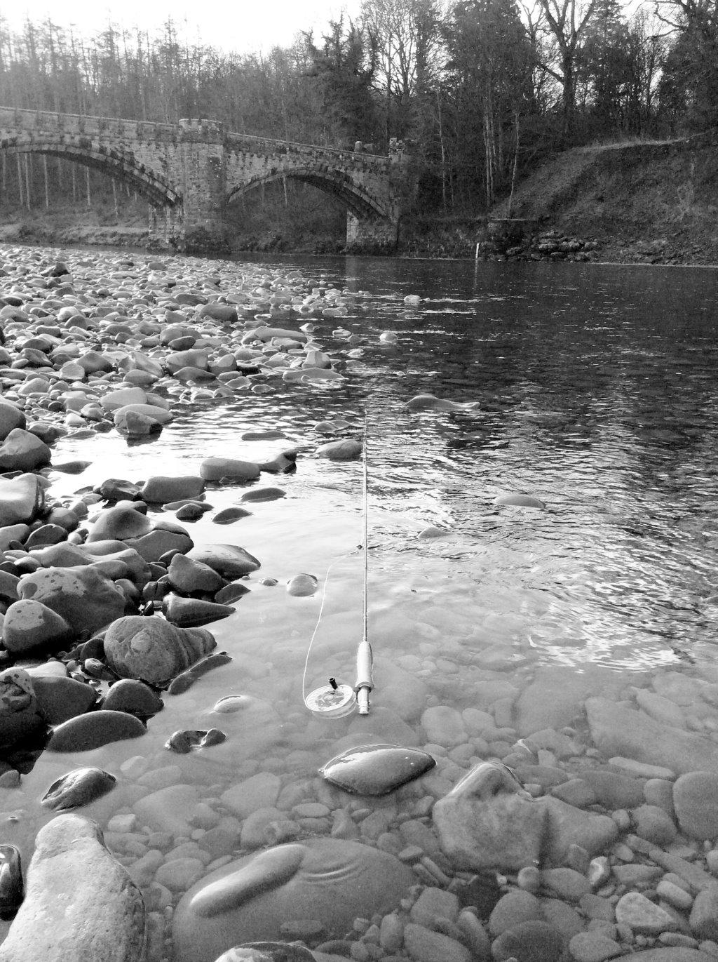 rod in river